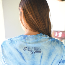 Load image into Gallery viewer, blue tie dye shirt back dolphin project logo