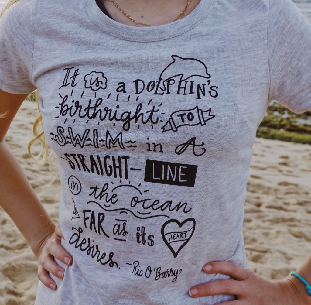 It's a dolphins birthright quote tee shirt
