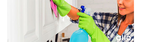 Kitchen cleaning tips, lady cleaning kitchen, dusting kitchen