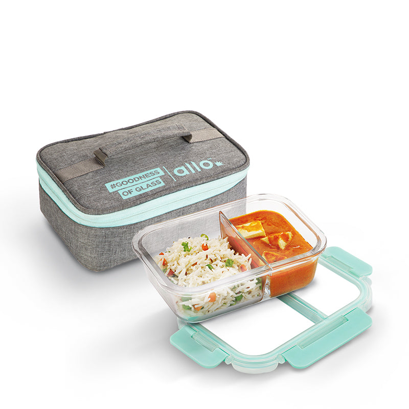 This rectangular glass Lunch box contains microwavable borosilicate glass container with two compartments of 580 ml capacity and a rectangular cover, ideal for office lunch breaks and school tiffins