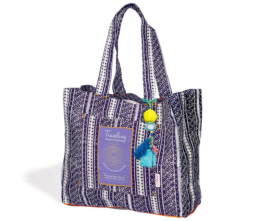 Traveling Heart Bag in Plum Mehndi, supports assault survivors