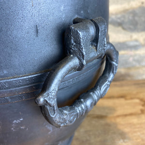 French pewter urn with decorative tap and fleur de lis design