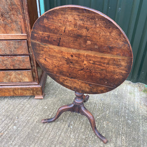 Tilt top round wine table