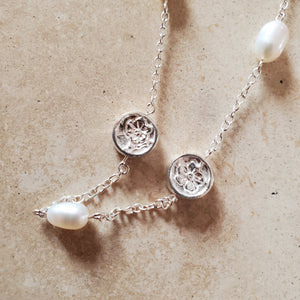 Silver and Pearl Necklace With Flowers