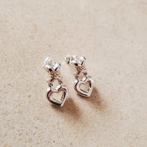 Silver X with Dangling Heart