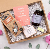 Gift box showing positive affirmations, strawberry lemonade tea, bath salts, soap and lip balm