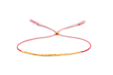 Delicate gold bracelet - red silk cord