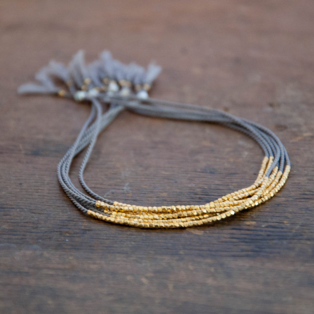 Delicate Gold on Gray Silk bracelet