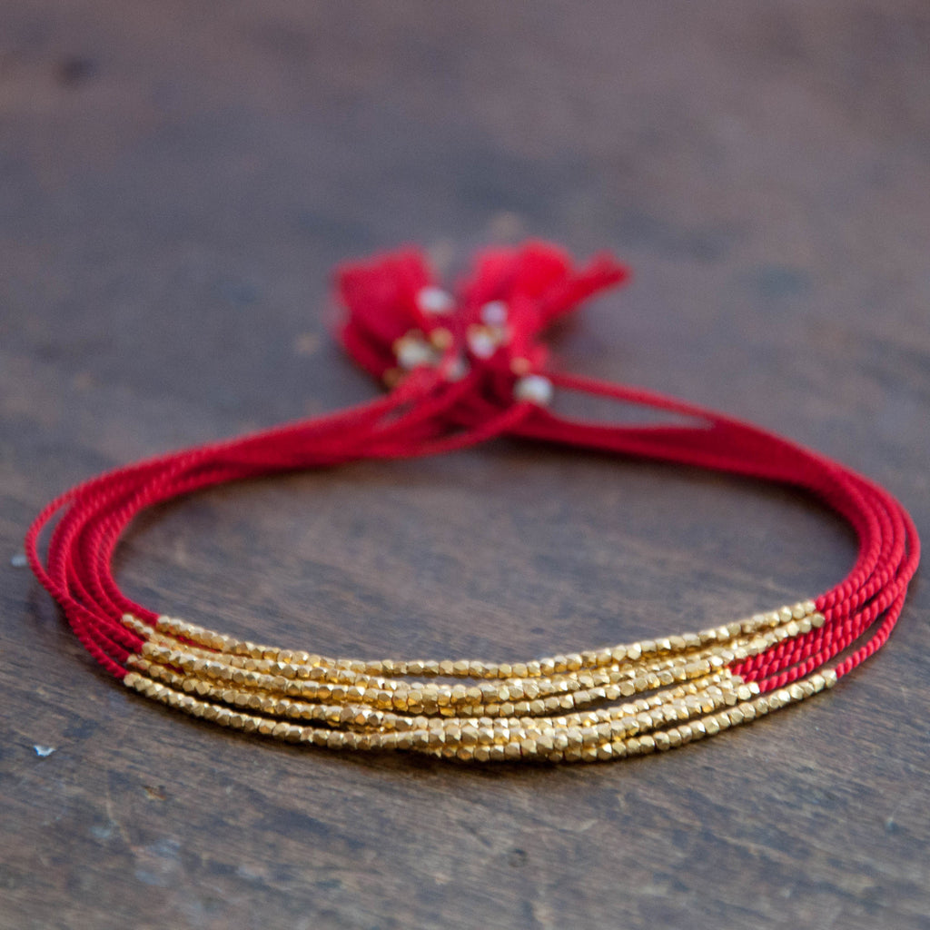with gold on string a shop mother eye white of kt pearl bracelet beads red god yellow solitary
