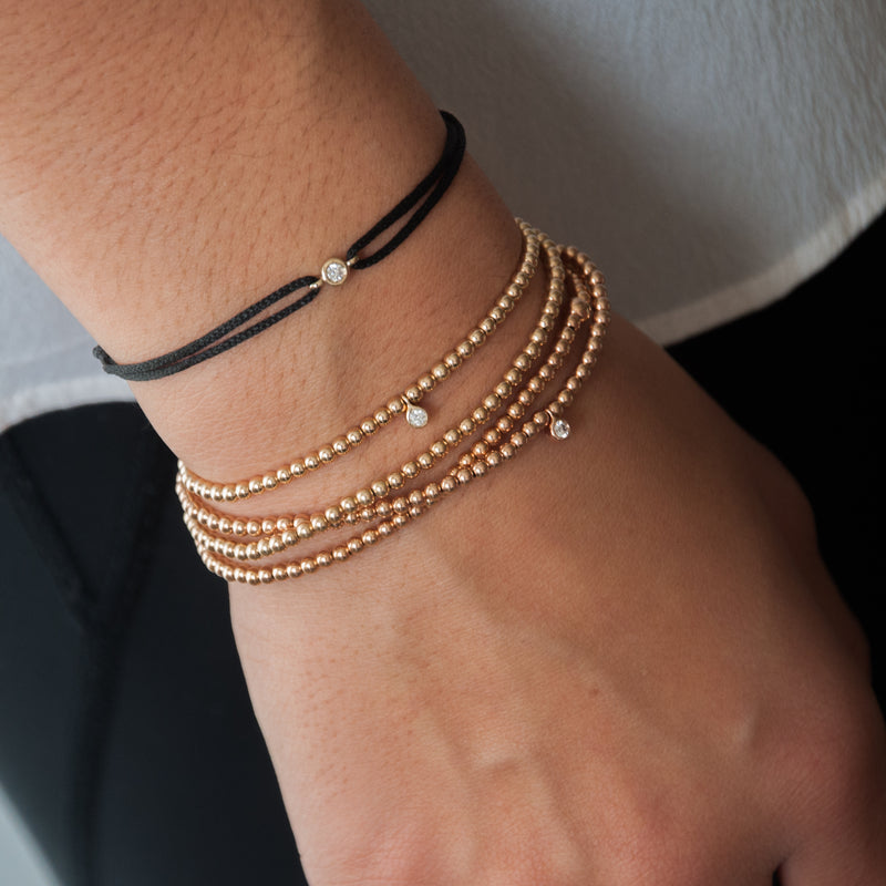 Gold Bead bracelet with diamond charm