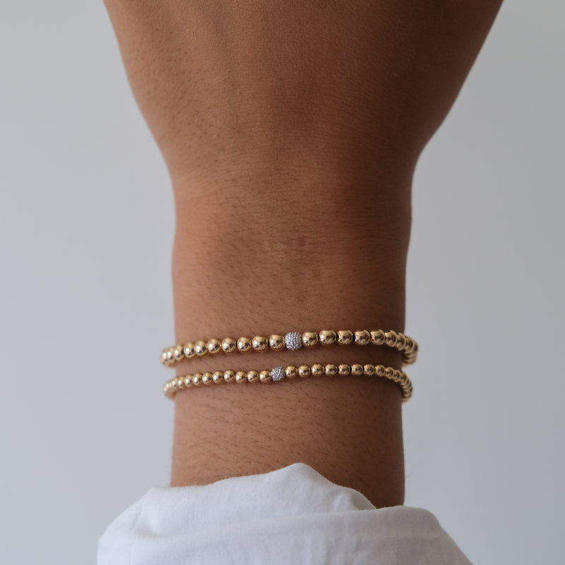 14k Yellow Gold beaded Bracelet with diamond accent
