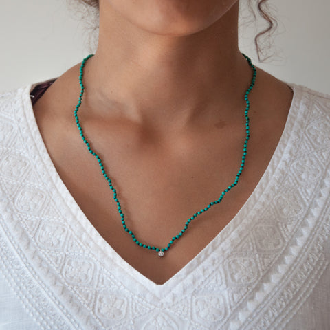 Turquoise knotted diamond charm necklace