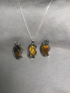 Tiger Eye within Silver Spiral Cage