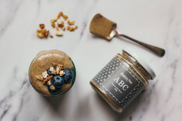 Coconut, kiwi & lime chia pudding recipe with ABC nut butter flat lay