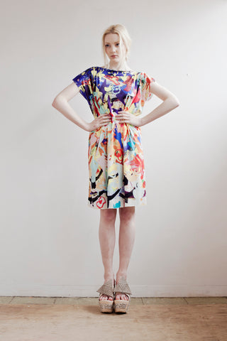 Bright, bold, colourful silk dress in dancing print