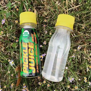 Pickle Juice Shot and Clear Shot Bottle on Grass