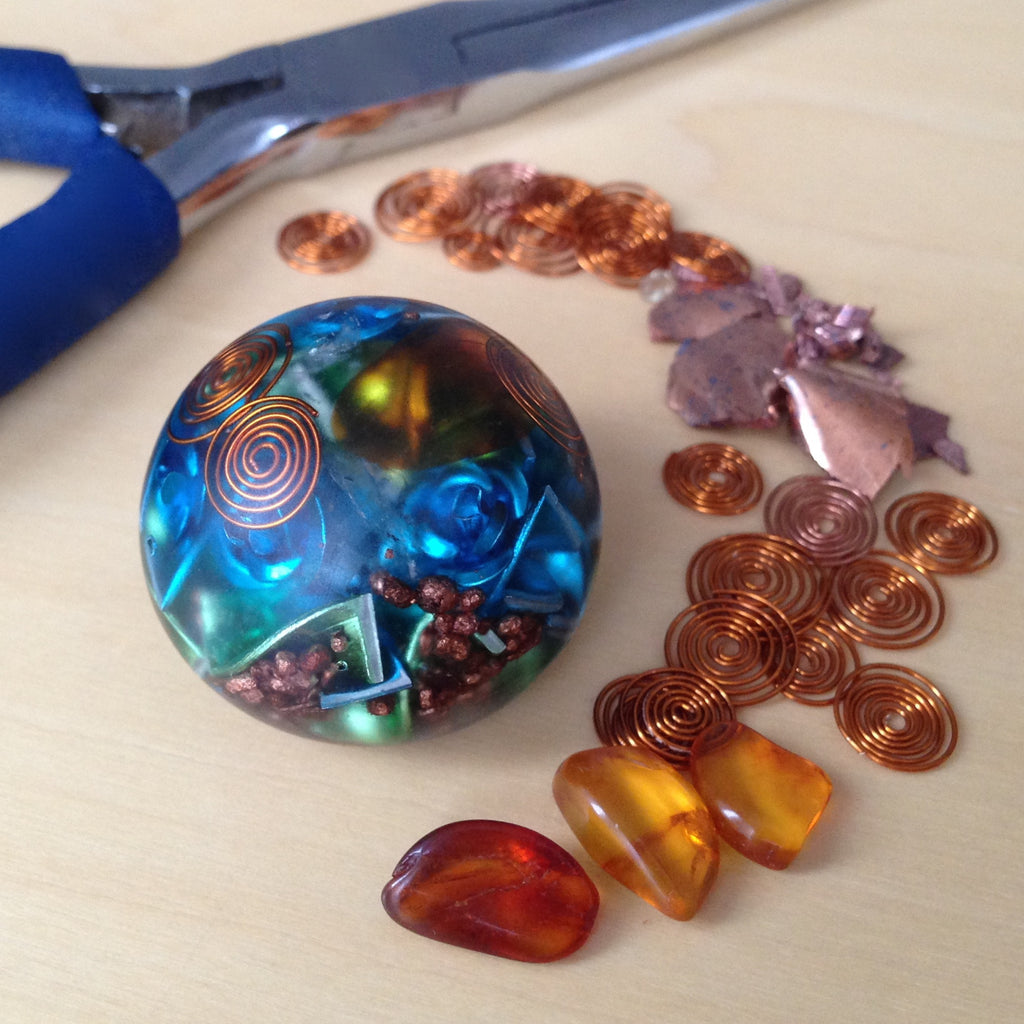 Orgone energy Sphere with Amber crystals