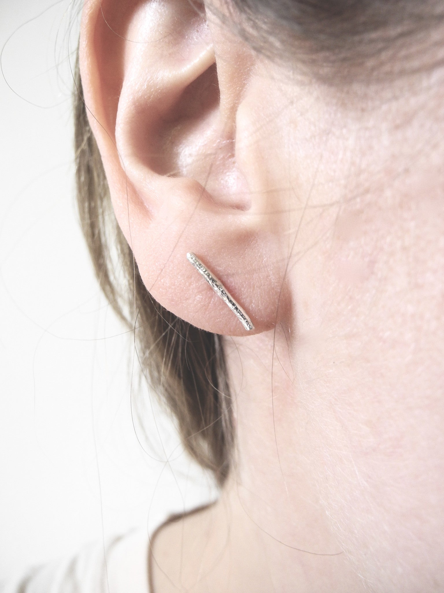 after nature mismatched stick earrings