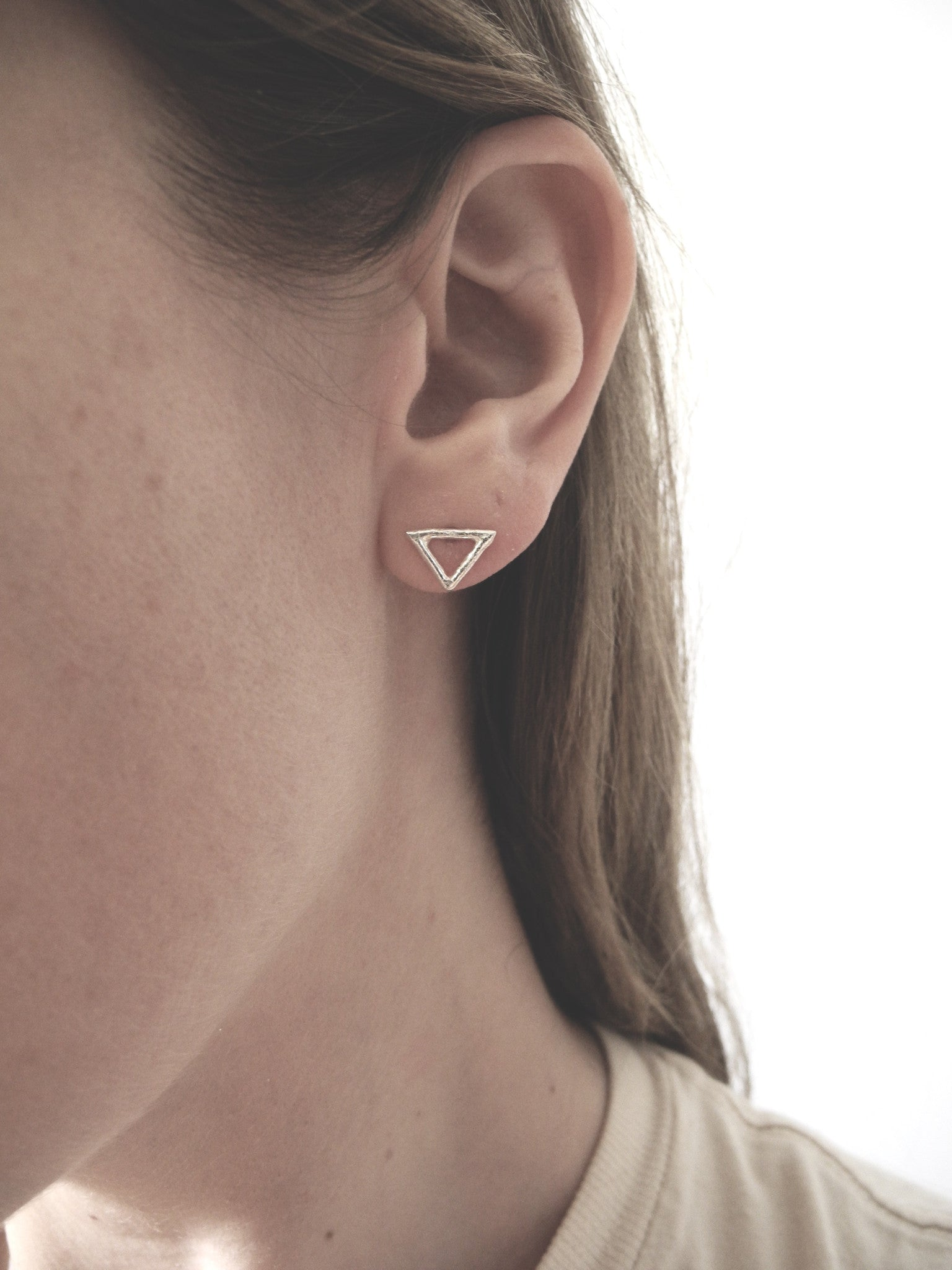 after nature small triangle studs