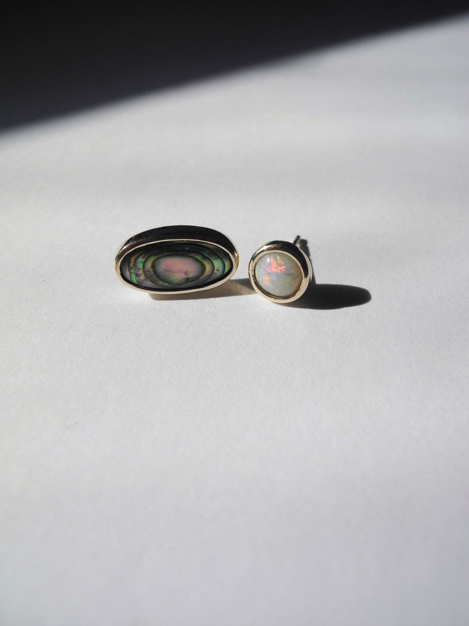 rainbow-essence studs in recycled 14k gold