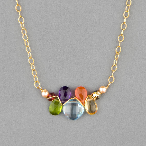 Anna Balkan Necklace: Mini Katie Gem, Gold with Blue Topaz