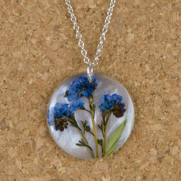 Shari Dixon Necklace: Forget Me Not on Shell, Large Round