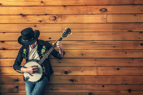 Man Playing Banjo Against Wood Wall Canvas