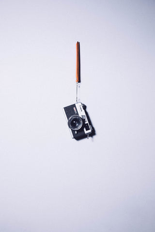 Vintage Camera Hanging on a Hook Wall Mural