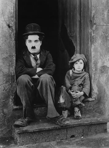 Chaplin Sitting with a Boy Canvas