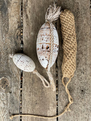 decorative nautical equiptment. rustic cork floats with a white paint finish and rope details with hanging loops. Fender is made from knotted rope with a long rope end for tying