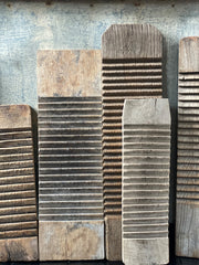 Assorted sizes and styles of weathered washboards. Washed out white wood to darker brown. Shows detail of ridges in the middle used for washing and smooth ends.