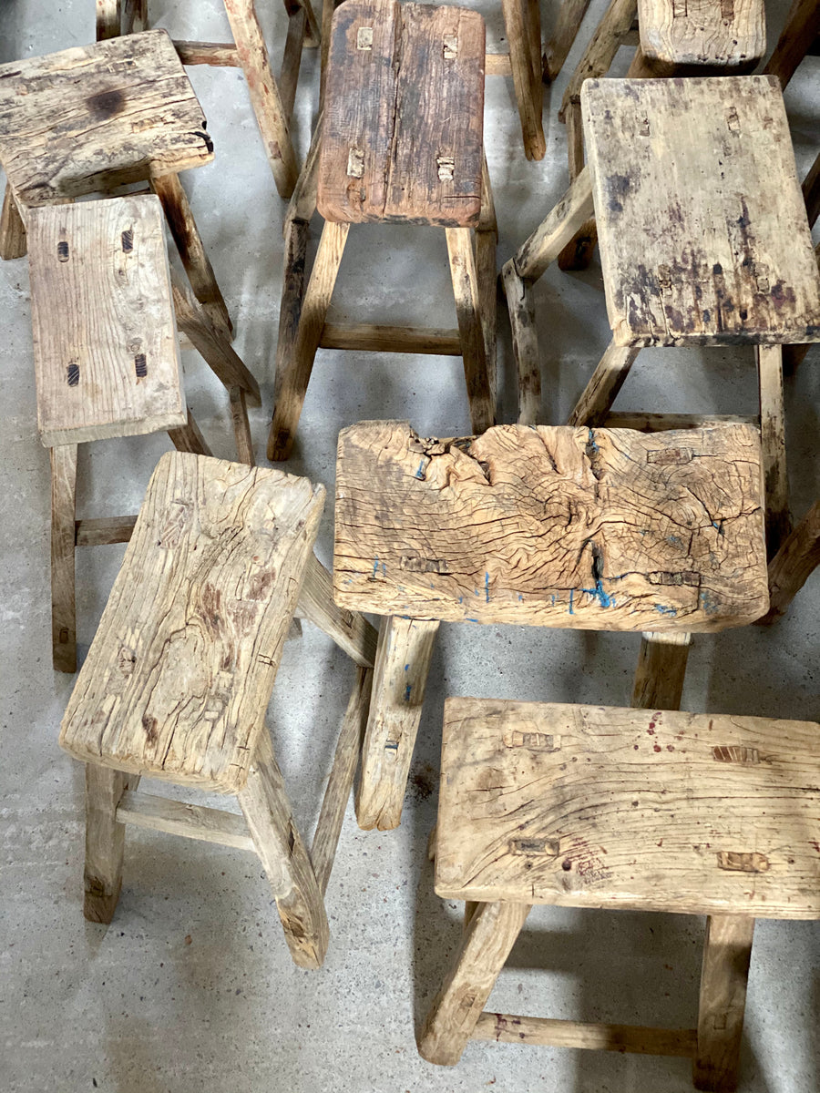 Assortment of old elm stools in different styles.