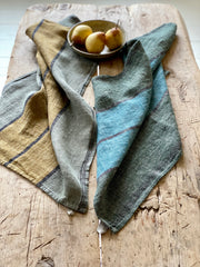 Linen tea towels. Olive and ochre with black stripe (left). Olive and teal with black stripe (right).