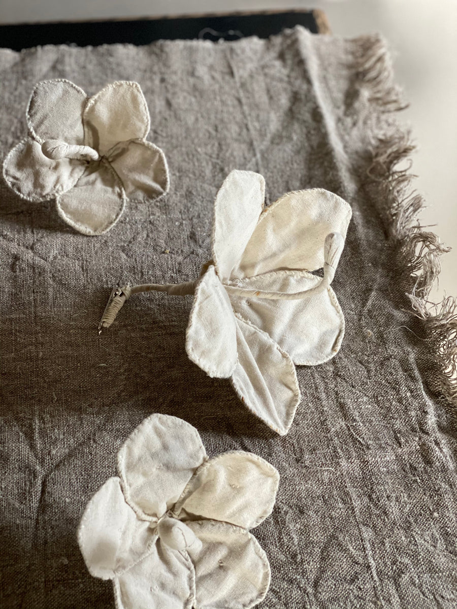 flowers made from recycled off-white canvas. Hibiscus style flower.