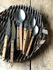 Cutlery with a  brushed gunmetal finish, made of a stainless steel and carbon alloy with a teak wood handle.