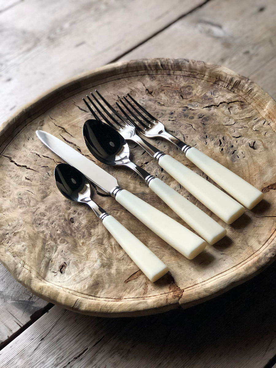 Ergonomically designed, stainless steel cutlery with antique matt white handles.