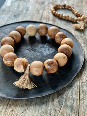 Chunky, honey coloured, olive wood beads. Strung on a natural coloured rope with tassel.