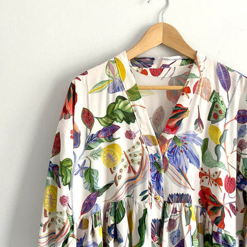 Image of the top of a colourful dress on a hanger