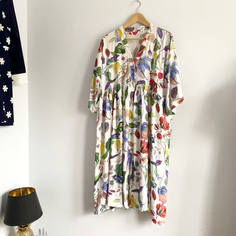 Image of a multicoloured dress on a hanger