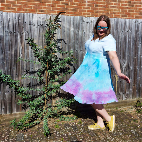 Image of Laura twirling in an ice dye border dress