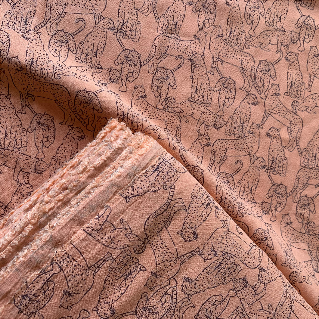 LOTS OF LEOPARDS ON PEACH LINEN VISCOSE FABRIC