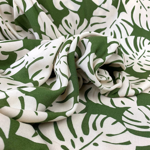 TROPICAL LEAVES ON OLIVE GREEN VISCOSE CHALLIS FABRIC