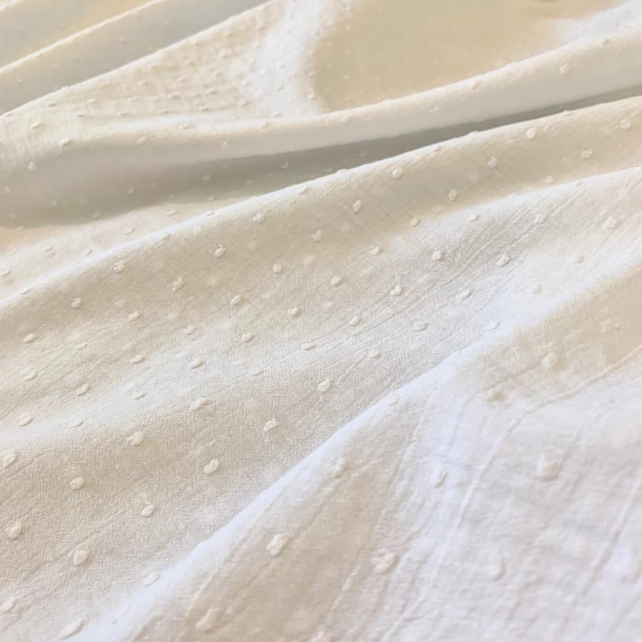 WHITE COTTON DOBBY WITH SPOT REMNANT 60CM X 135CM