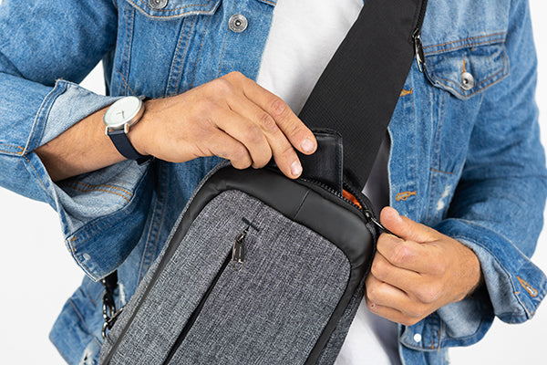 Zoomlite Sling bag with anti-theft features has a quick access pocket