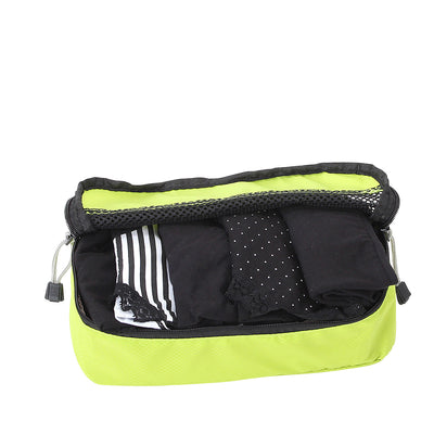 Slim Packing Cube in Lime packed with undies