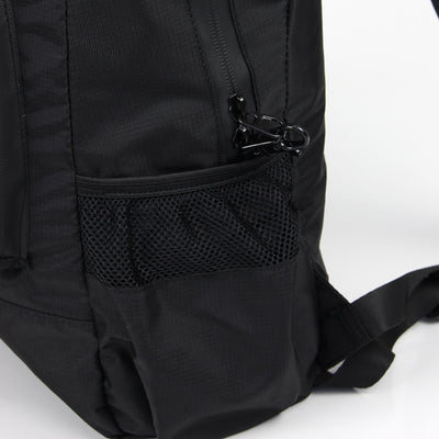 Zoomlite foldaway backpack has water bottle pocket and locking zip pullers