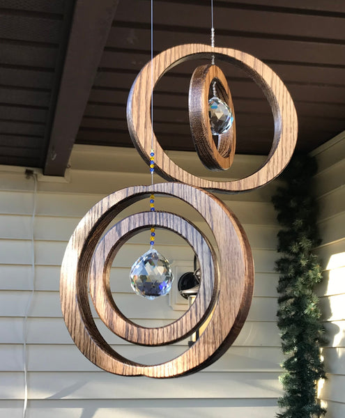 Sparkling double framed sun catchers with a round pendant and colorful accents