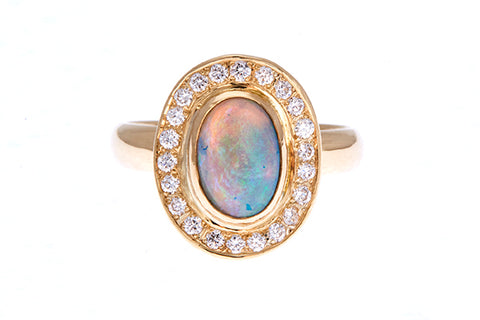 18ct ring in yellow gold with Australian solid opal 1.26cts & diamond surround.