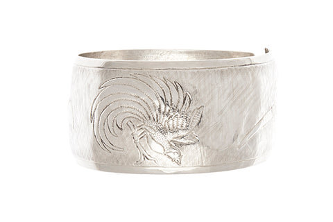 Silver PNG Motif Repousse Cuff