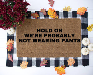 Hold On We're Not Wearing Pants funny Door Mat